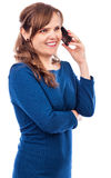 Pretty young lady speaking on the phone and smiling Royalty Free Stock Images