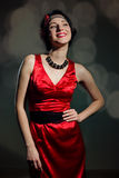Pretty young lady in a stylish red dress Stock Image