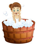 A pretty young lady taking a bath Stock Photography