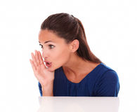 Pretty young lady whispering a secret stock photography
