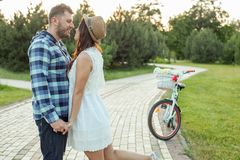 Pretty young loving couple is dating in park royalty free stock photography
