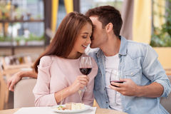 Pretty young loving couple is dating in restaurant Stock Images