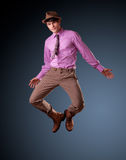Pretty young male jumping - clean studio shoot Stock Image