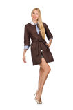 The pretty young model in brown jacket isolated on white Royalty Free Stock Photography