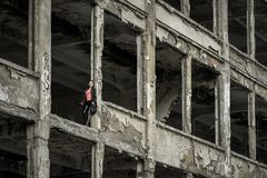 Pretty girl in ruined building. Pretty young model girl posing in ruined building stock photography