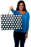 Pretty young model posing with shopping bag Stock Image