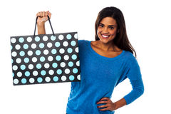 Pretty young model posing with shopping bag Stock Photography