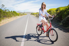 Pretty young model riding bike Royalty Free Stock Photo