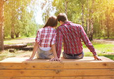 Pretty young modern couple in love resting outdoors stock photos