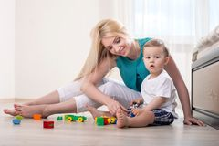 Pretty young mom is spending time with her baby Royalty Free Stock Images