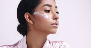 Beautiful young girl`s skin care routine stock footage