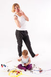 Pretty young mother and daughter draw picture Royalty Free Stock Images