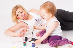 Pretty young mother and daughter drawing Stock Photography