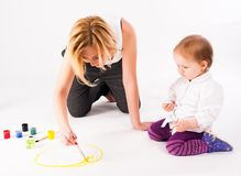 Pretty young mother and daughter drawing Stock Images