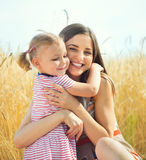 Pretty young mother with daughter are happy in sunny day Royalty Free Stock Photos