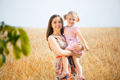 Pretty young mother with daughter are happy in sunny day Royalty Free Stock Photo