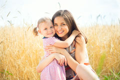 Pretty young mother with daughter are happy in sunny day Stock Photo