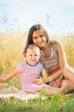 Pretty young mother with daughter are happy in sunny day Stock Image