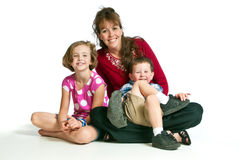 Pretty young mother with her two children Royalty Free Stock Image