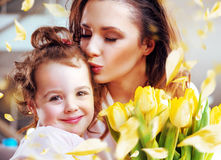 Pretty young mother kissing daughter Stock Photography