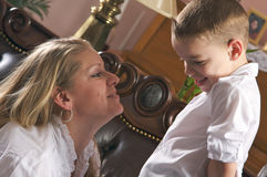 Pretty Young Mother and Son. Young Mother and Son Enjoying a Tender Moment Stock Photography