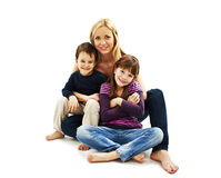 Pretty young mother with son and daughter. Isolated on a white background Stock Image