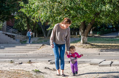 Free Pretty Young Mother Walking With Her Daughter Beautiful Baby Girl, And Playing In The Park Among The Trees And Bushes Royalty Free Stock Photography - 59725747
