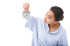 Pretty young mulatto girl holding alarm clock Stock Photo