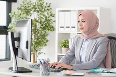 Pretty young muslim office employee woman