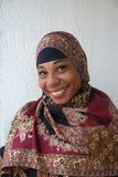 Pretty Young Muslim Woman. A potrait of a pretty young muslim woman smiling at camera Stock Images
