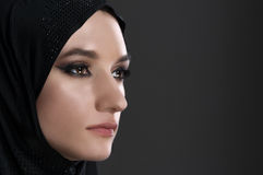 Pretty young muslim woman head shot over gray background Royalty Free Stock Images