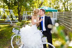 Pretty young newlyweds with bike Stock Photography