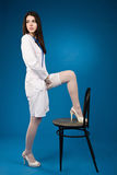 A pretty young nurse straightens stockings Royalty Free Stock Images