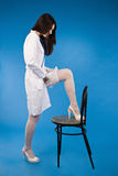 A pretty young nurse straightens stockings Stock Photos