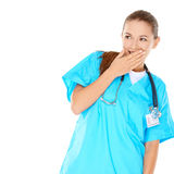 Pretty young nurse trying to hide her amusement Stock Images