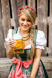 Pretty young oktoberfest blonde woman in a dirndl dress with beer Stock Photography