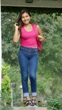 Girl Wearing Blue Jeans. A pretty young Peruvian teen girl royalty free stock image