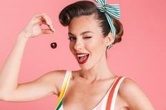 Pretty young pin up woman holding cherry. Stock Image