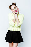 Pretty young playful girl dressed in green pullover and black skirt. Stock Photography