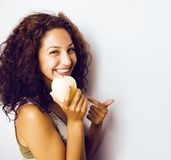 Pretty young real tenage girl eating apple close up smiling Royalty Free Stock Image