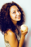 Pretty young real tenage girl eating apple close up smiling Royalty Free Stock Photos