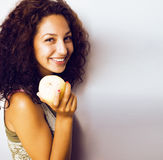 Pretty young real tenage girl eating apple close up smiling Stock Images