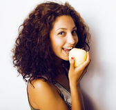 Pretty young real tenage girl eating apple close up smiling Royalty Free Stock Photo