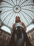 Pretty young red hair woman posing in moll, Galleria Umberto I, Napoli, Roma Stock Photography