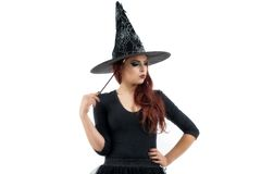 Pretty young redhead witch Royalty Free Stock Photo