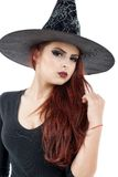 Pretty young redhead witch Stock Image