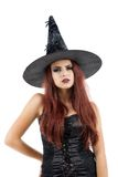 Pretty young redhead witch Royalty Free Stock Photography