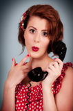 Pretty young retro styled female using phone Stock Images