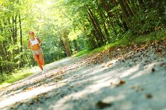 Pretty Young Runner. Pretty young girl runner in the forest stock photos