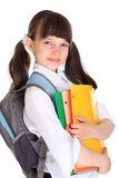 Pretty young schoolgirl. Studio portrait of a pretty, smiling young schoolgirl wearing a backpack and carrying folders, isolated on a white background Stock Photo